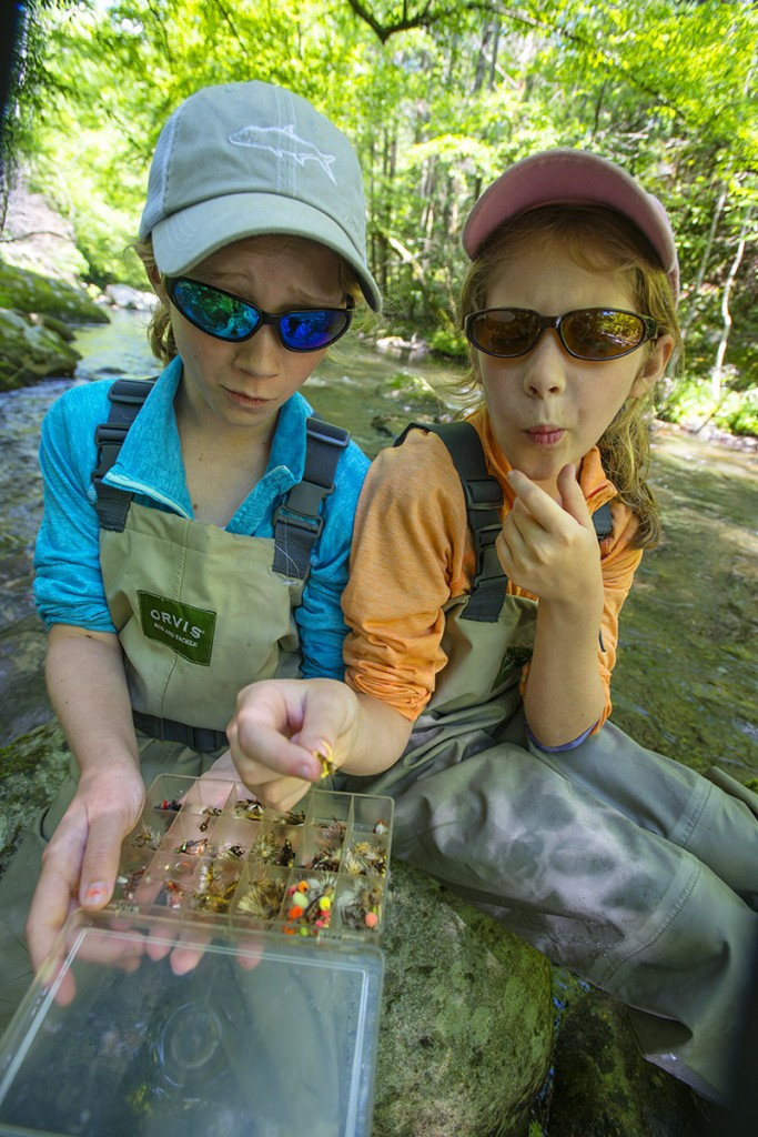 Girls in Orvis, picking flies for fishing