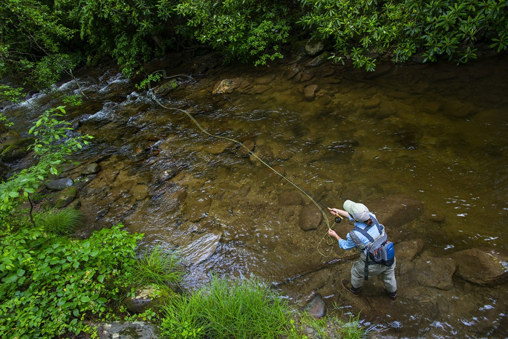 Lady in Orvis gear casting to trout in the Smokies